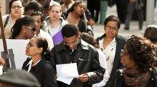 Unemployed workers wait in line to get into a job fair in New York on Oct. 2. (Emile Wamsteker/Bloomberg)