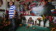 The ghost of Hugo Chavez looms heavy over Venezuela nearly a year after his death as protests rack the country. (Jorge Silva/REUTERS)