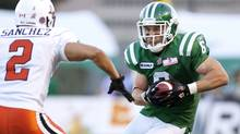 Saskatchewan Roughriders wide receiver Rob Bagg (R) looks to run past B.C. Lions cornerback Davis Sanchez during the first half of their CFL football game in Regina, Saskatchewan August 12, 2010. (Reuters)