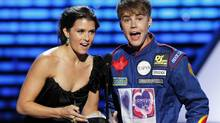 Singer Justin Bieber and NASCAR and open wheel race car driver Danica Patrick present an award at the 2011 ESPY Awards in Los Angeles, California, July 13, 2011. REUTERS/Mario Anzuoni (Mario Anzuoni/Reuters)