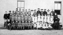 First Nations students are shown at St. Paul's Indian Industrial School in Middlechurch, Man., in 1901. Native leaders and human-rights experts are pressing the federal government to recognize that Canada's treatment of native people constituted genocide. (LIBRARY AND ARCHIVES CANADA)