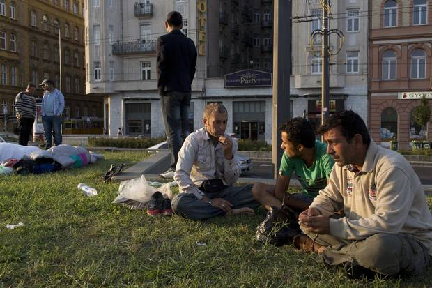 Refugees from Afghanistan wait early in the morning outside the Keleti train station.