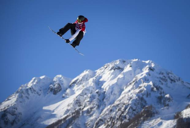 Canadian snowboarder Mark McMorris sails through the air the slopestyle event at the Rosa Khutor Exterme Park February 8, 2014 during the Sochi Winter Olympics.
