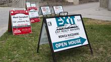 Real estate signs sit outside of the Marina Del Rey condos on Lake Shore Boulevard West in Toronto. (Matthew Sherwood For The Globe and Mail)