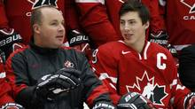 Head coach Steve Spott (L) talks to team captain Ryan Nugent-Hopkins during the team photo after the Canadian National Junior team was named at the Team Canada selection camp in Calgary, Alberta, December 14, 2012. (TODD KOROL/REUTERS)