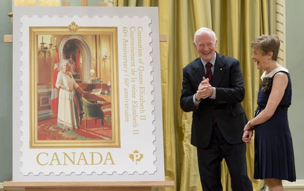 Govovernor-General David Johnston and his wife, Sharon, unveil a postage stamp commemorating the 60th anniversary of the Queen's coronation at Rideau Hall on May 8, 2013.