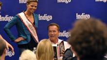 "Arnold Schwarzenegger signing copies of his new autobiography ""Total Recall"" for Miss Canada 2012 Jaclyn Miles at Indigo in Toronto October 4, 2012. (Mike Cassese)"