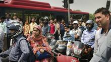 Rush hour commuters wait in New Delhi, India, Monday, May 16, 2011. (Gurinder Osan/(AP Photo/Gurinder Osan))