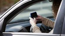 Lower Mainland cops handed out 4,449 distracted driving tickets in a one month enforcement blitz. (Globe files/Globe files)