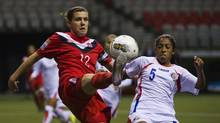 Costa Rica's Diana Saenz (R) and Canada's Christine Sinclair try to control the ball during the first half of their CONCACAF women's Olympic qualifying soccer match in Vancouver, British Columbia January 23, 2012. (ANDY CLARK/REUTERS)