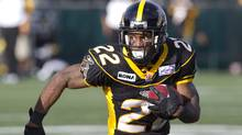 Hamilton Tiger-Cats' Avon Cobourne runs the ball during first half CFL football action against the Winnipeg Blue Bombers in Hamilton, Ont. Friday, July 1, 2011 (The Canadian Press)