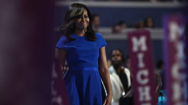 First lady Michelle Obama walks on stage before delivering remarks on the first day of the Democratic National Convention at the Wells Fargo Center, July 25, 2016 in Philadelphia, Pennsylvania.