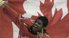 Pk Subban of Canada celebrates with national flag winning the gold medal at the 2008 IIHF World U20 Ice Hockey Championships in Pardubice, some 130 kilometers (about 85 miles) east of Prague, Czech Republic, Saturday, Jan. 5, 2008. Canada defeated Sweden 3-2 in overtime and got the 4th consecutive junior title. (AP Photo/Petr David Josek ) (Petr David Josek)