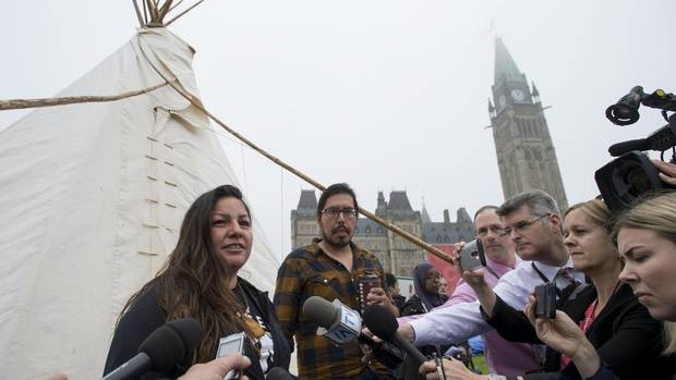 Candace Day Neveau speaks to reporters after Prime Minister Justin Trudeau met with people in a teepee on Parliament Hill in Ottawa on Friday, June 30, 2017.