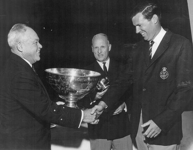 Perry Connolly, right, in his Royal Canadian Yacht Club blazer, accepting a trophy.