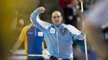 Quebec skip Jean-Michel Menard celebrates after making his last shot to defeat Alberta 7-5 at the Tim Hortons Brier in Kamloops, B.C. on Friday, March 7. (Andrew Vaughan/THE CANADIAN PRESS)