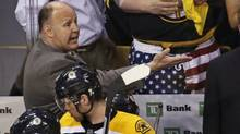 Boston Bruins coach Claude Julien argues with officials late in the third period against the Toronto Maple Leafs during Game 5 of an NHL hockey Stanley Cup playoff series, in Boston on Friday, May 10, 2013. The Maple Leafs won 2-1. (AP)