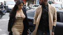 TV personality Kim Kardashian and rapper Kanye West arrive at a fashion designer workshop in Paris May 21, 2014. (GONZALO FUENTES/REUTERS)