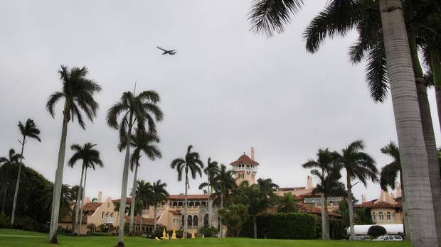 An airplane on approach to the West Palm Beach airport flies over the Mar-a-Lago estate in Palm Beach, Fla., where U.S. president-elect Donald Trump is staying.