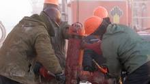 OAO Rosneft employess work in temperatures of around -40C at the Vankor oil field in eastern Siberia, in a file photo. (SERGEI KARPUKHIN/REUTERS)