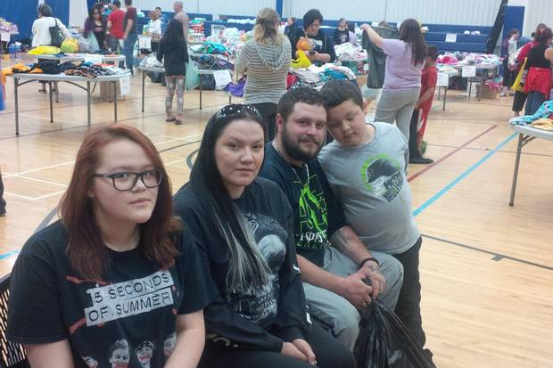 Jeff Cheecham and his fiancee Crystal Powder evacuated from Anzac with their daughter Cyndel, son Cyrus and pets Wednesday night. They collected donated goods at the evacuation centre in Lac La Biche. They are pictured at the evacuation centre in Lac La Biche Thursday, May 5, 2016. Carrie Tait/The Globe and Mail