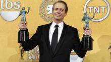 "Actor Steve Buscemi poses with his awards for outstanding performance by a male actor in a drama series and outstanding performance by an ensemble in a drama series for ""Boardwalk Empire"" at the 18th annual Screen Actors Guild Awards in Los Angeles, California January 29, 2012. Researchers found that the kind of fame Buscemi has never really goes away in the media. (Mike Blake/Reuters)"