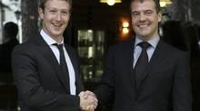 Facebook CEO Mark Zuckerberg donned a suit and tie for his meeting outside Moscow with Russian Prime Minister Dmitry Medvedev on Oct. 1, 2012. Like Mr. Zuckerberg, Workday co-founder Dave Duffield will retain control of his company after its upcoming IPO. (RIA Novosti/REUTERS)