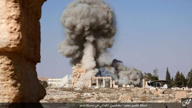 An undated image, published by the Islamic State group in the Homs province (Welayat Homs) on Aug. 25, 2015, allegedly shows smoke billowing from the Baal Shamin temple in Syria's ancient city of Palmyra. The temple was reportedly destroyed by the extremist group.