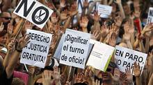 "Protesters show banners reading "" No cuts"", ""dignify the jobs"" and ""right to free justice"" to demonstrate against the country's near 25 per cent unemployment rate and stinging austerity measures introduced by the government, in Madrid, Spain, Saturday, July 21, 2012. (Andres Kudacki/AP)"