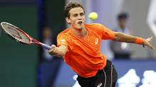 Canada's Vasek Pospisil returns a shot against France's Richard Gasquet (Eugene Hoshiko/AP)