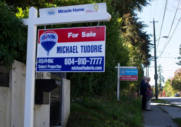 For-sale signs are seen outside houses for sale in Point Grey.