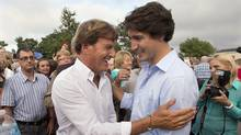 Liberal leader Justin Trudeau, right, chats with Stephen Bronfman, the party's chief fundraiser, at a barn party in St. Peters Bay, PEI, on Aug. 28, 2013. (ANDREW VAUGHAN/THE CANADIAN PRESS)