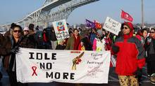 Aboriginal protesters and supporters in the Idle No More movement march on their way to blocking the Blue Water Bridge to the United States in Sarnia, Ont. on Saturday, January 5, 2013. The closing of the bridge lasted about an hour. (Dave Chidley/The Canadian Press)
