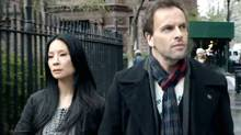Lucy Liu and Jonny Lee Miller in a scene from Elementary. (Global)