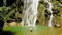 Visitors to the magnificent Boca da Onca waterfall, the highest in the state, must first rappel 90 metres before they can relax in its waters. (Robin Esrock)