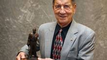 Ted Lindsay poses with his Lester Patrick Award October 22, 2008 at the St. Paul Hotel in St. Paul, Minnesota. (Scott A. Schneider/Getty Images)