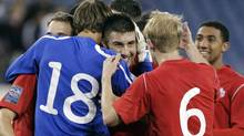 Canada's Lucas Cavallini, center, celebrates with teammates Michal Misiewicz (18) and Kyle Bekker (6) after they defeated the United States 2-0 in a CONCACAF Olympic qualifying soccer match on Saturday, March 24, 2012, in Nashville, Tenn. Cavallini scored a goal in the win. (AP Photo/Mark Humphrey) (Mark Humphrey)