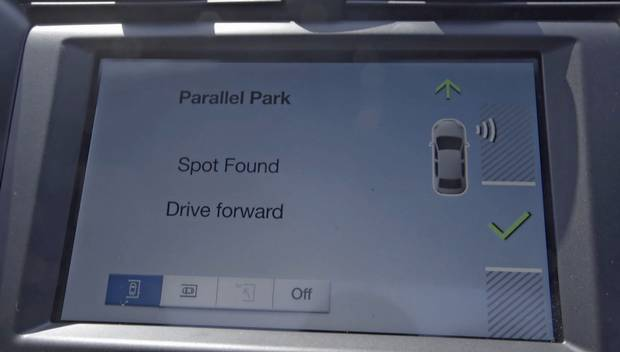 The display of a Ford Fusion shows when a parking spot has been found and the car is ready to park itself.