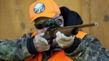 A rifle owner checks takes aim at a hunting camp near Ottawa on Sept. 15, 2010. (Sean Kilpatrick/THE CANADIAN PRESS)