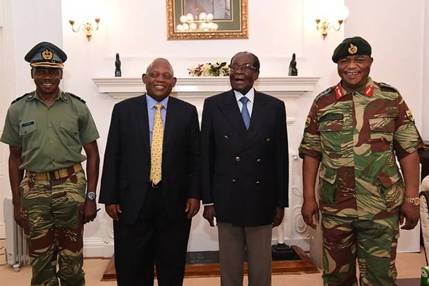 Nov. 16: A screengrab from Zimbabwe Broadcasting Corporation shows Mr. Mugabe, second from right, with General Constantino Chiwenga, right, and South African envoys in Harare.