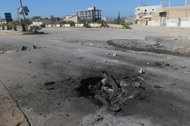 A crater is seen at the site of an airstrike, after what rescue workers described as a suspected gas attack in the town of Khan Sheikhoun.