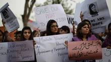 Pakistani women in Islamabad hold banners during a protest condemning the attack on schoolgirl Malala Yousufzai. (Muhammed Muheisen/AP)