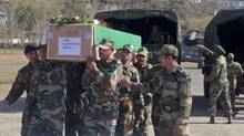 Indian Army soldiers carry a coffin containing the body of a colleague who was allegedly killed by Pakistani soldiers, at Rajouri, India, Jan. 9, 2013. (Channi Anand/AP)