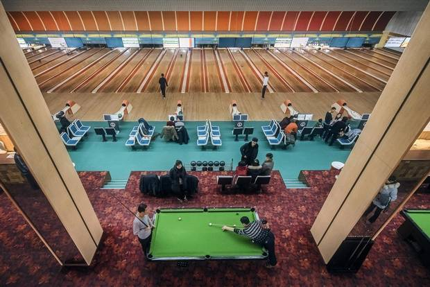 The last stages of a pool game play out against a soundtrack of strikes, spares and gutter balls at a bowling alley in East Pyongyang. With a standard six-day work week in North Korea, Sunday is the day for relaxation.
