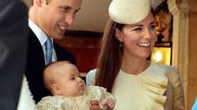 Britain's Prince William, Kate Duchess of Cambridge with their son Prince George arrive at the Chapel Royal in St James's Palace in London, for the christening of the three month-old Prince George, Wednesday Oct. 23, 2013. (John Stillwell/AP)