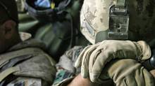 A Canadian soldier rests on the muzzle of his rifle while riding in an armoured vehicle in Kandahar province on Nov. 16, 2007. (FINBARR O'REILLY/Reuters)