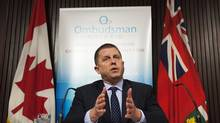 Ontario Ombudsman Andre Marin speaks at a news conference at Queens Park in Toronto on Feb. 4, 2014. (Aaron Vincent Elkaim/THE CANADIAN PRESS)