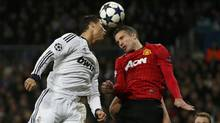 Manchester United's Robin van Persie challenges Real Madrid's Cristiano Ronaldo during their Champions League soccer match at Santiago Bernabeu stadium in Madrid February 13, 2013. (JUAN MEDINA/REUTERS)