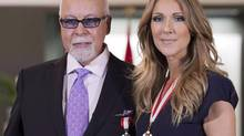 Canadian music star Celine Dion and husband Rene Angelil pose for photos after being decorated with the Order of Canada in Quebec City on Friday July 26, 2013. (JACQUES BOISSINOT/THE CANADIAN PRESS)