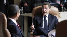 U.S. President Barack Obama listens to France's President Nicolas Sarkozy as the leaders of the G8 sit down for their first working session of the final day at the G8 Summit in Huntsville, Ont. (CHRIS WATTIE/REUTERS/Chris Wattie)